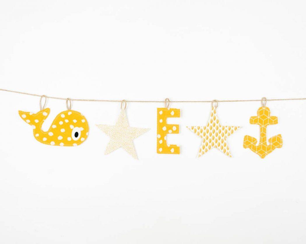 Motivgirlande in ocker. Motivgirlanden sind tolle Geschenke zur Geburt oder Taufe.
